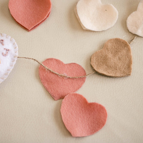 Felt hearts and twine for a DIY Valentine garland.