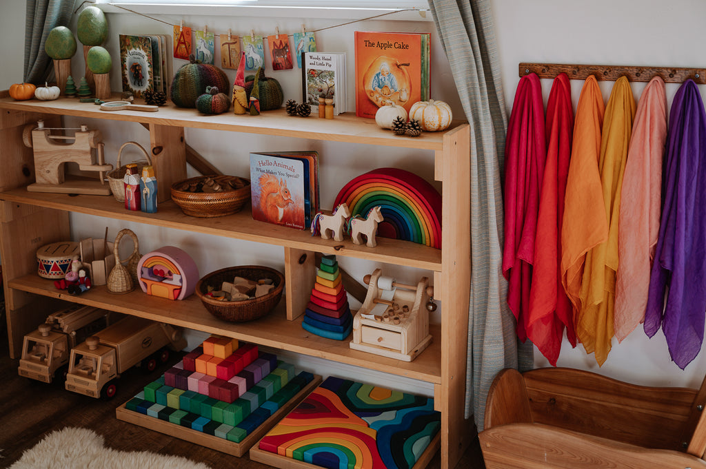 A curated toy shelf featuring Grimm's Wooden Toys and more from Bella Luna Toys