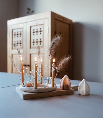 A homemade Advent candle holder with beeswax candles