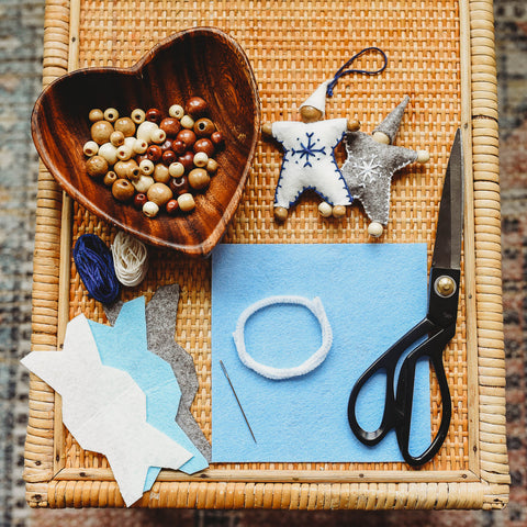 Felt, beads, and other materials to craft felt waldorf snowflake children