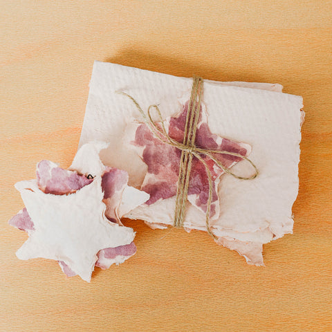A bundle of handmade thank you cards made from recycled paper.