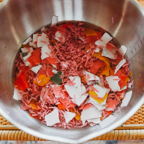 Shredded paper soaking to make paper pulp. DIY paper tutorial papermaking