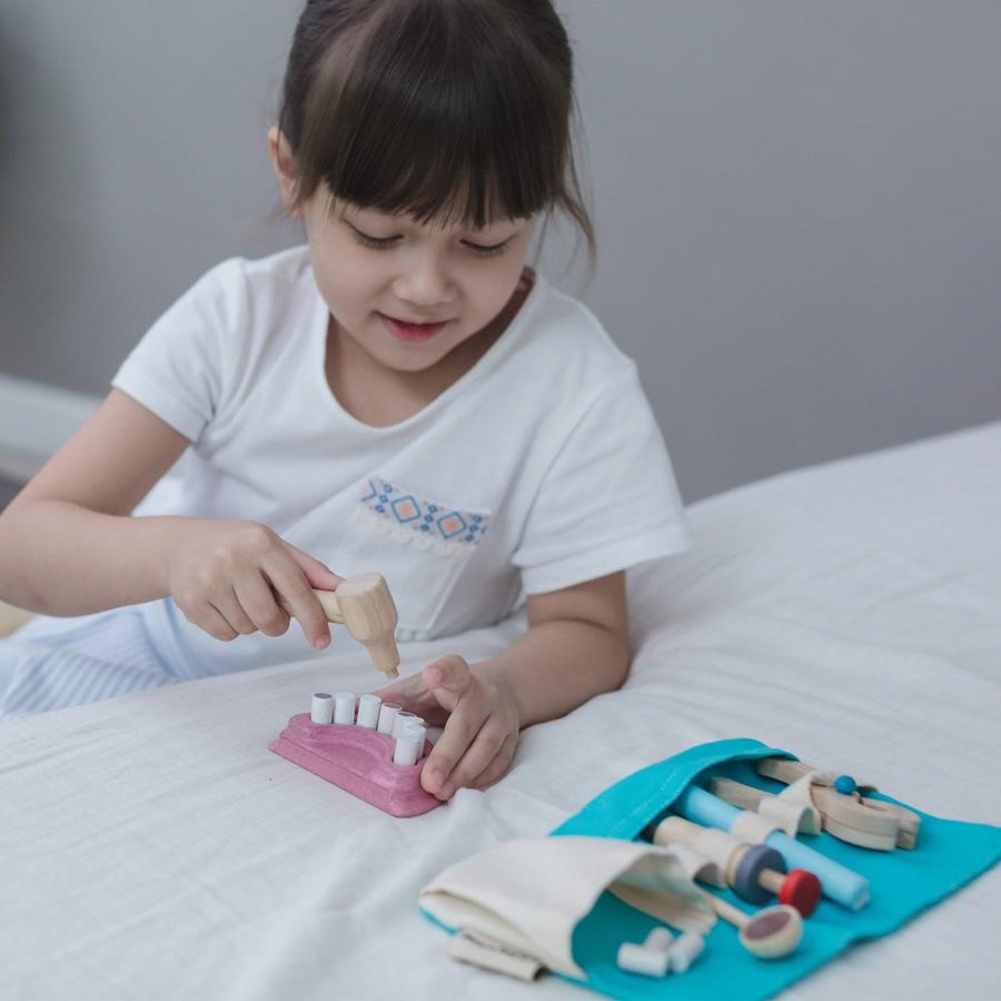 Plan Toys Dentist Set - Girl Playing