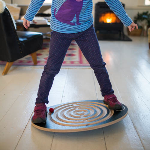 Balancing on Labyrinth Wooden Balance Board