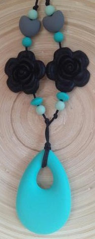 Turquoise Teething Pendant with Black Flowers