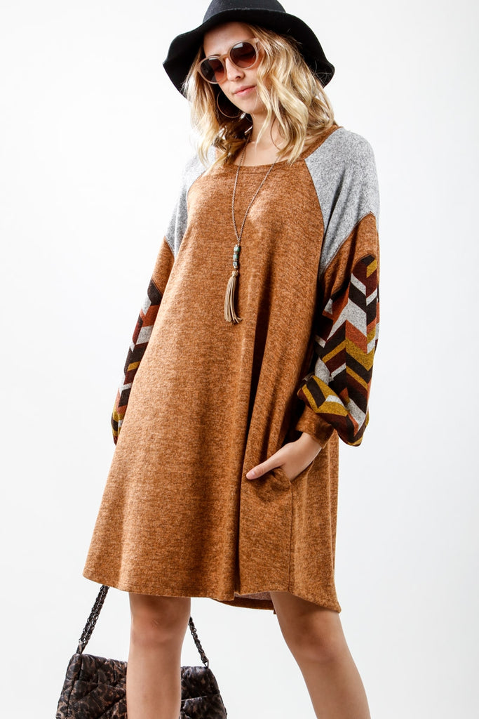 Long chevron puff sleeved knit dress with pockets