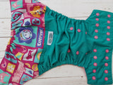 Puppy Patrol (jade pul raspberry awj, two toned snaps; seaspray caps, hot pink pieces) <br>Wrap Around, One Size Pocket Diaper<br>Instock and Ready to Ship