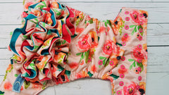 Coral Floral WITH Coordinating Specialty Ruffle (magenta awj, two toned snaps; apple caps, hot pink pieces)<br>Poly Traditional, One Size Pocket Diaper<br>Instock and Ready to Ship