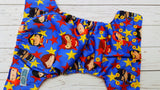 Hero Girl (red awj, two toned snaps; red caps, marigold pieces)<br>Traditional, One Size Pocket Diaper<br>Instock and Ready to Ship