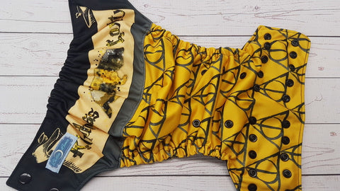 Hufflepuff House (black awj & snaps) <br>Performance Knit Traditional, One Size Pocket Diaper<br>Instock and Ready to Ship