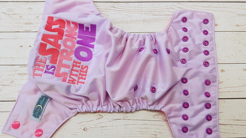 Sass Is Stong  (lavender pul, raspberry awj, two toned snaps; hot pink caps, violet pieces)<br>Embroidered, One Size Pocket Diaper<br>Instock and Ready to Ship