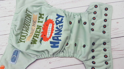 LE Mint Surprise Hangry (le mint pul, navy awj, two toned snaps; orange caps, navy pieces) <br>Embroidered, One Size Pocket Diaper<br>Instock and Ready to Ship