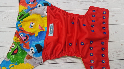 Street Friends (red pul, citron awj, two toned snaps; marigold caps, royal pieces) <br>Wrap Around, One Size Pocket Diaper<br>Instock and Ready to Ship
