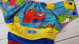 Chugg Chugg (red awj, two toned snaps; royal blue caps, red pieces) <br>Wrapped Crazy Scrappy, One Size Pocket Diaper<br>Instock and Ready to Ship