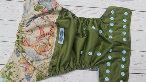 Pooh Bear On Olive (olive pul, light blue awj & snaps)<br>Wrap Around, One Size Pocket Diaper<br>Instock and Ready to Ship