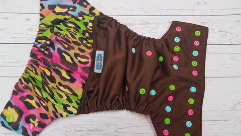 Chocolate Cheetah (brown pul, magenta awj, multi snaps; apple, hot pink, seaspray alternating) <br>Wrap Around, One Size Pocket Diaper<br>Instock and Ready to Ship
