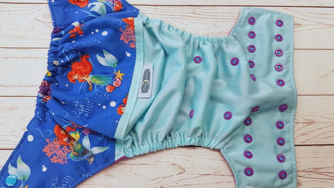 Just Gotta Sing ( seaspray pul, violet awj, two toned snaps; aqua caps, violet pieces) <br>Wrap Around, One Size Pocket Diaper<br>Instock and Ready to Ship