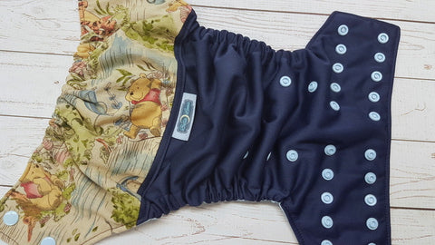 Pooh Bear On Navy (navy pul, light blue awj & snaps)<br>Wrap Around, One Size Pocket Diaper<br>Instock and Ready to Ship