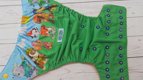 Watercolor Pup Patrol (kelly pul, orange awj, two toned snaps; marigold caps, royal pieces) <br>PK Wrap Around, One Size Pocket Diaper<br>Instock and Ready to Ship