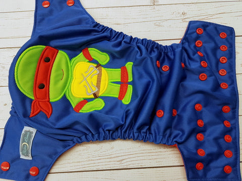 Red TMNT (royal blue pul, red awj & snaps) <br>Embroidered, One Size Pocket Diaper<br>Instock and Ready to Ship