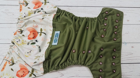 Friendly Flowers (olive pul, butter awj, two toned snaps; light pink caps, bronze pieces) <br>PK Wrap Around, One Size Pocket Diaper<br>Instock and Ready to Ship