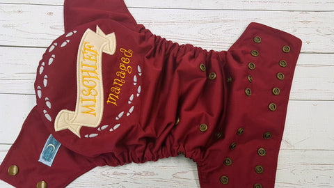 Burgundy Mischief Managed Swear (brown awj, bronze snaps) <br>Embroidered, One Size Pocket Diaper<br>Instock and Ready to Ship