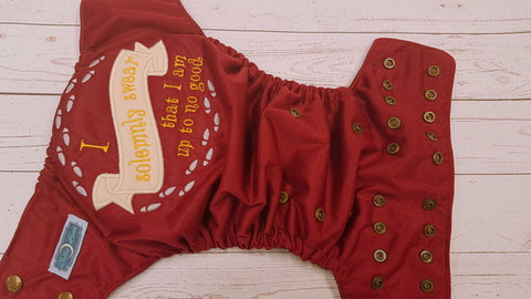 Burgundy Solemnly Swear (brown awj, bronze snaps) <br>Embroidered, One Size Pocket Diaper<br>Instock and Ready to Ship