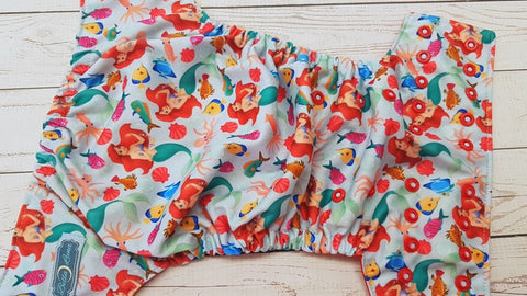Under The Sea Princess (red awj, two toned snaps; light blue caps, red pieces) <br>Traditional, One Size Pocket Diaper<br>Instock and Ready to Ship