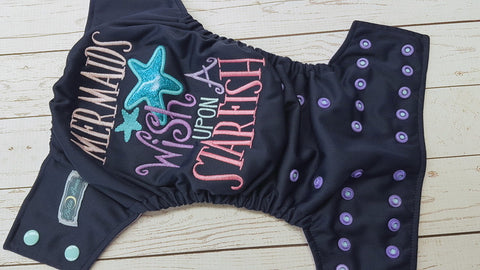 Wish Upon A Starfish (navy pul, lavender awj, two toned snap; seaspray caps. med. purple pieces) <br>Embroidered, One Size Pocket Diaper<br>Instock and Ready to Ship