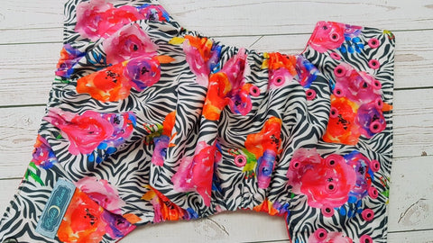 Zebra Floral (magenta awj, two toned snaps; black caps, hot pink pieces) 6.1 <br>Traditional, One Size Pocket Diaper<br>Instock and Ready to Ship
