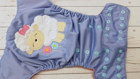 Spring Lamb (dusty lavender pul, raspberry awj, two toned snaps; light pink caps, seaspray pieces) 4.13 <br>Embroidered, One Size Pocket Diaper<br>Instock and Ready to Ship