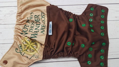 Not All Those Who Wander... (brown pul & awj, two toned snaps; brown caps, kelly pieces) <br>PK Wrap Around, One Size Pocket Diaper<br>Instock and Ready to Ship