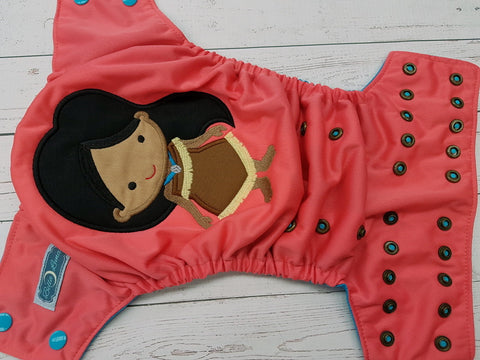Coral Tribal Princess (coral pul, aqua awj, two toned snaps; aqua caps, bronze) <br>Embroidered, One Size Pocket Diaper<br>Instock and Ready to Ship