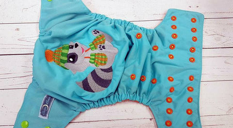 Winter Racoon (SO caribbean pul, orange awj, two toned snaps; apple caps, orange pieces) <br>Embroidered, One Size Pocket Diaper<br>Instock and Ready to Ship