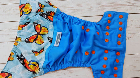 Among The Butterflies (aqua pul, orange awj & snaps) 8.3<br>PK Wrap Around, One Size Pocket Diaper<br>Instock and Ready to Ship