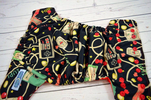Retro Controllers ( red snaps ) <br>Performance Knit Traditional, One Size Pocket Diaper<br>Instock and Ready to Ship