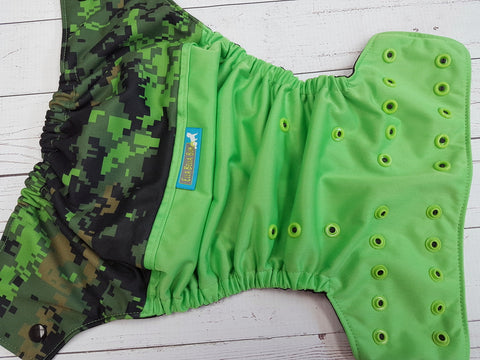 Reserved DTP- Camo PK Wrap Around OS Pocket Diaper (ribbit outer, aqua tag, black inner, two toned snaps; black caps, apple pieces)<br>One Size Pocket Diaper<br>Instock and Ready to Ship