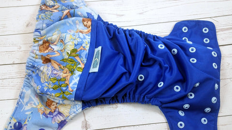 Royal Glitter Faries ( Royal outer two-toned snaps-- royal caps / light blue pieces )<br>Wrap Around, One Size Pocket Diaper<br>Instock and Ready to Ship