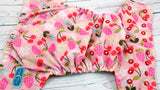 Cherry Berry Blossom (two-toned snaps, white caps / red pieces )<br>Traditional, One Size Pocket Diaper<br>Instock and Ready to Ship