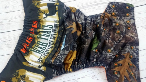 Derricks Deer Tracks (printed pul outer, two-toned snaps - orange caps / bronze pieces )<br>Wrap Around, One Size Pocket Diaper<br>Instock and Ready to Ship
