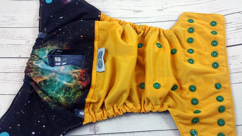 Tardis Time Travel (marigold outer, two-toned snaps aqua caps / kelly pieces)<br>Wrap Around, One Size Pocket Diaper<br>Instock and Ready to Ship