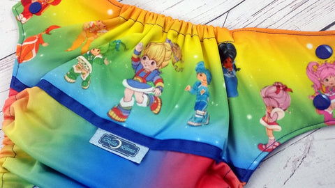 Ultimate Rainbow Bright (printed pul, royal awj & snaps)<br>Wrap Around, One Size Pocket Diaper<br>Instock and Ready to Ship