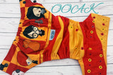 My Favorite Wizard ( black caps / marigold and red pieces alternating ) <br>ONE OF A KIND<br>One Size Pocket Diaper<br>Instock and Ready to Ship