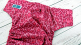 Pink Cheetah (black awj, two toned snaps; hot pink caps, black pieces) <br>Traditional, One Size Pocket Diaper<br>Instock and Ready to Ship