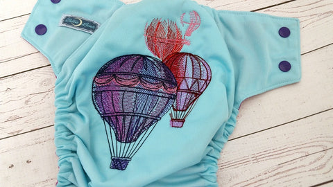 Hot Air Balloons (seaspray pul, violet awj, two toned snaps; imperial caps, violet pieces) <br>Embroidered, One Size Pocket Diaper<br>Instock and Ready to Ship