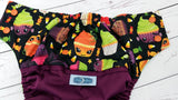 Scary Cupcakes (plum pul, spring green awj, two toned snaps; orange caps, apple pieces) <br>Wrap Around, One Size Pocket Diaper<br>Instock and Ready to Ship