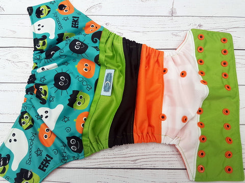 Cute Little Ghoulz (orange awj, two toned snaps; black caps, orange pieces) <br>PK Wrapped Crazy Scrappy, One Size Pocket Diaper<br>Instock and Ready to Ship
