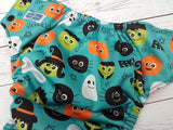 Cute Little Ghoulz (PK outer, orange inner, two toned snaps; orange caps, black pieces) <br>Traditional, One Size Pocket Diaper<br>Instock and Ready to Ship