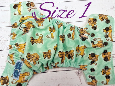 NEWBORN Lion Cubs (butter awj, bronze snaps) <br>Traditional Size One Pocket Diaper<br>Instock and Ready to Ship