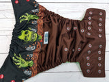 Soil Breaker Exclusive (brown pul, spring green awj, two toned snaps; red caps, silver pieces) <br>Wrap Around, One Size Pocket Diaper<br>Instock and Ready to Ship